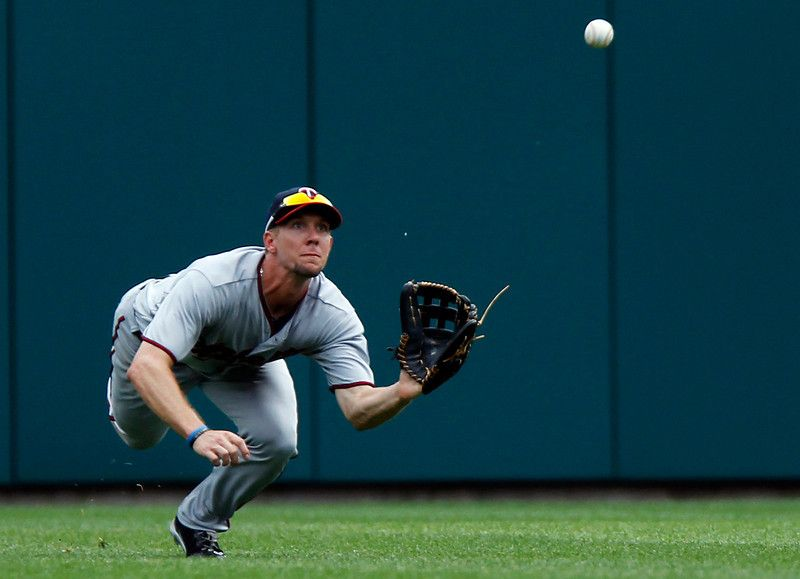 Minnesota Twins center fielder Clete Thomas dives to make the catch on a fly ball hit by Detroit Tigers' Omar Infante in the seventh inning of a baseball game on Thursday, Aug. 22, 2013, in Detroit. (AP Photo/Duane Burleson