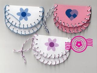 DIY paper purses laced with bakers twine or craft threads. Blanket stitch around. Fun summer project for kids. Free template - pdf or svg  and tutorial.  The Papercraft Post: Pretty Little Purses http://thepapercraftpost.blogspot.com/2013/08/pretty-little-purses.html  #papercraft    based on laced leathercraft purses  :-)
