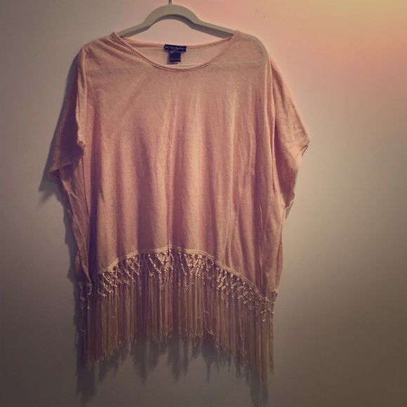 Slightly sheer beige fringe top Slightly sheer beige fringe top. Pull over style batwing shirt with a fringe hemline. Super cute and bohemian! Sleeves are tacked inside. Worn only a few times. Measures about 20 inches shoulder to hem, 60 inches across with sleeves, 19 inches waist and bust. See You Monday Tops Tees - Short Sleeve