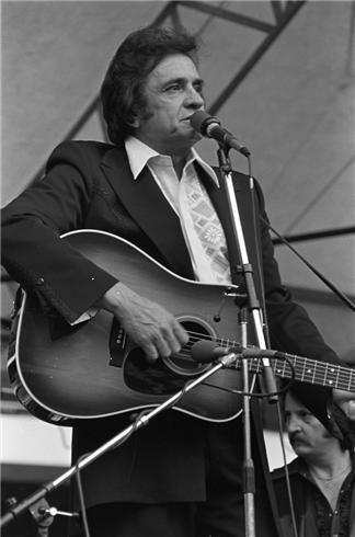 Johnny Cash Playing Guitar   Johnny Cash   Lynn Goldsmith