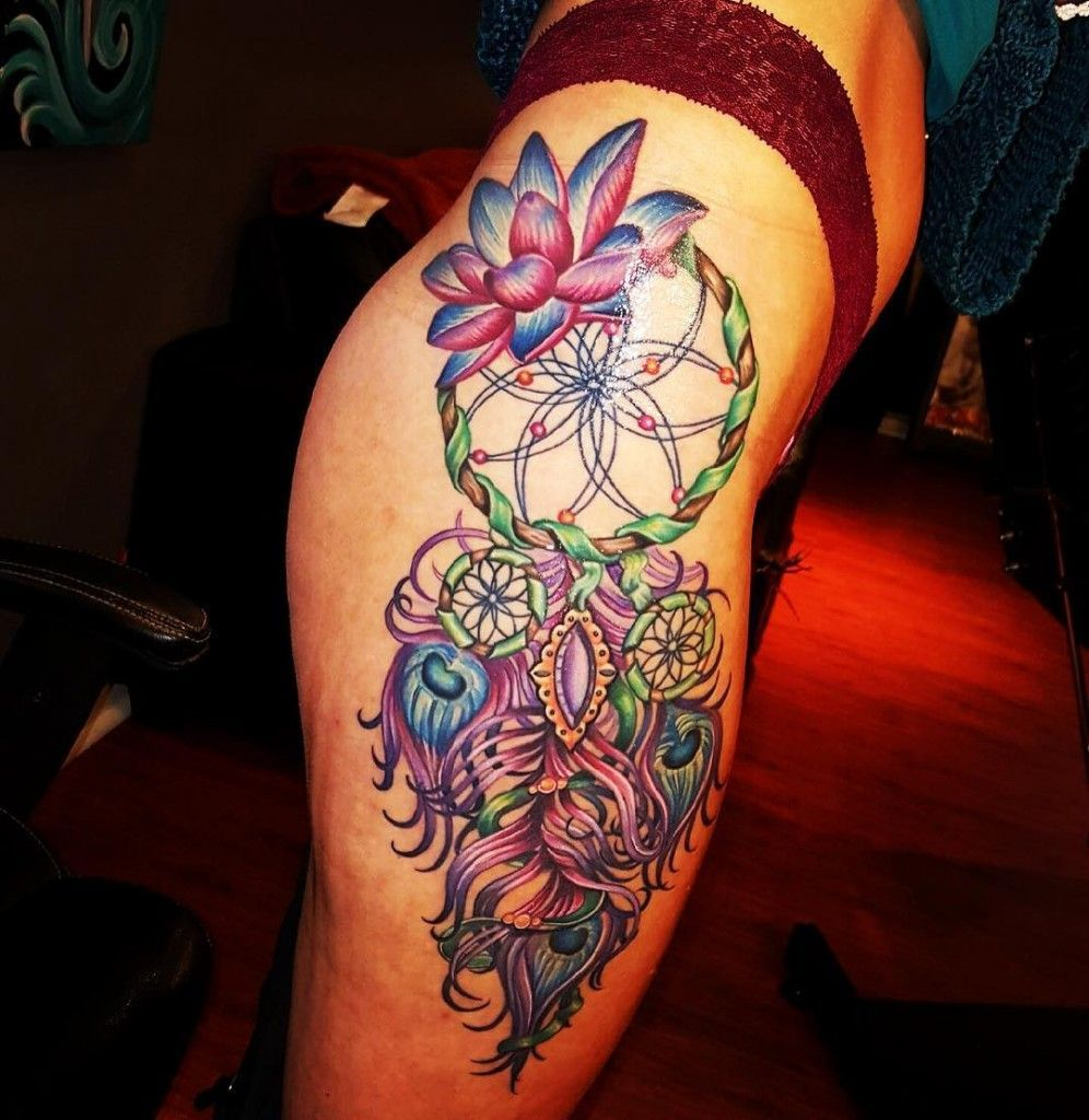 Tattoo on the thighs of the girl dream catcher and lotus tattoo izmirmasajfo Gallery