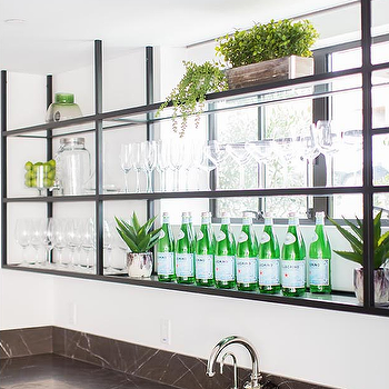 Glass And Iron Bar Shelf In Front Of Windows Glass Shelves