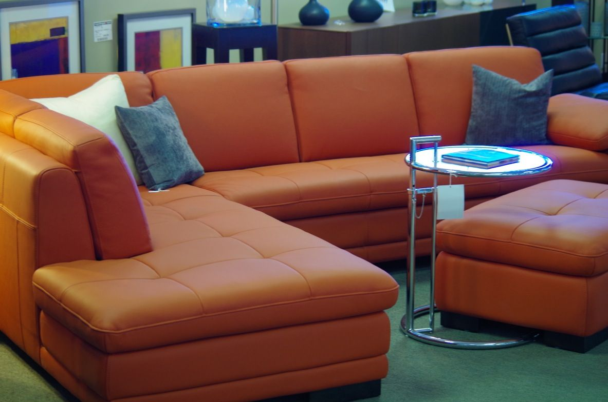 Our Citrine Leather Sectional And Optional Ottoman In