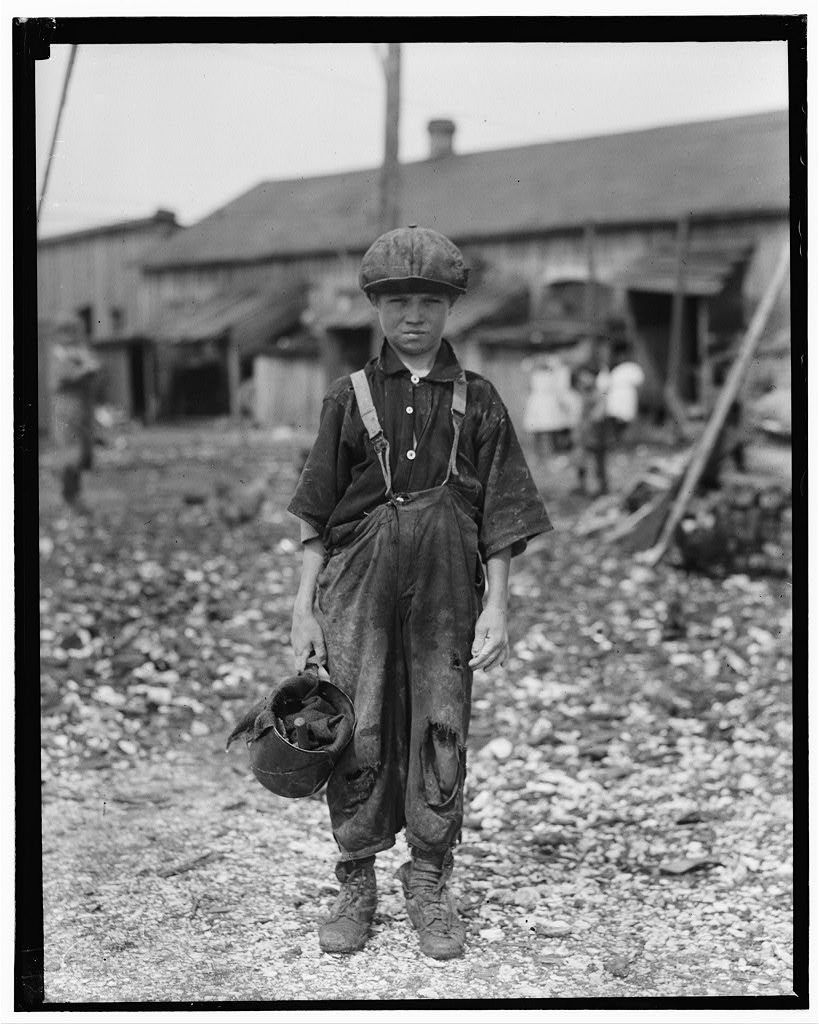 Henry, 10 year old oyster shucker who does five pots of oyster [sic] a day. Works before school, after school, and Saturdays. Been working three years. Maggioni Canning Co. Port Royal, South Carolina in February 1912.