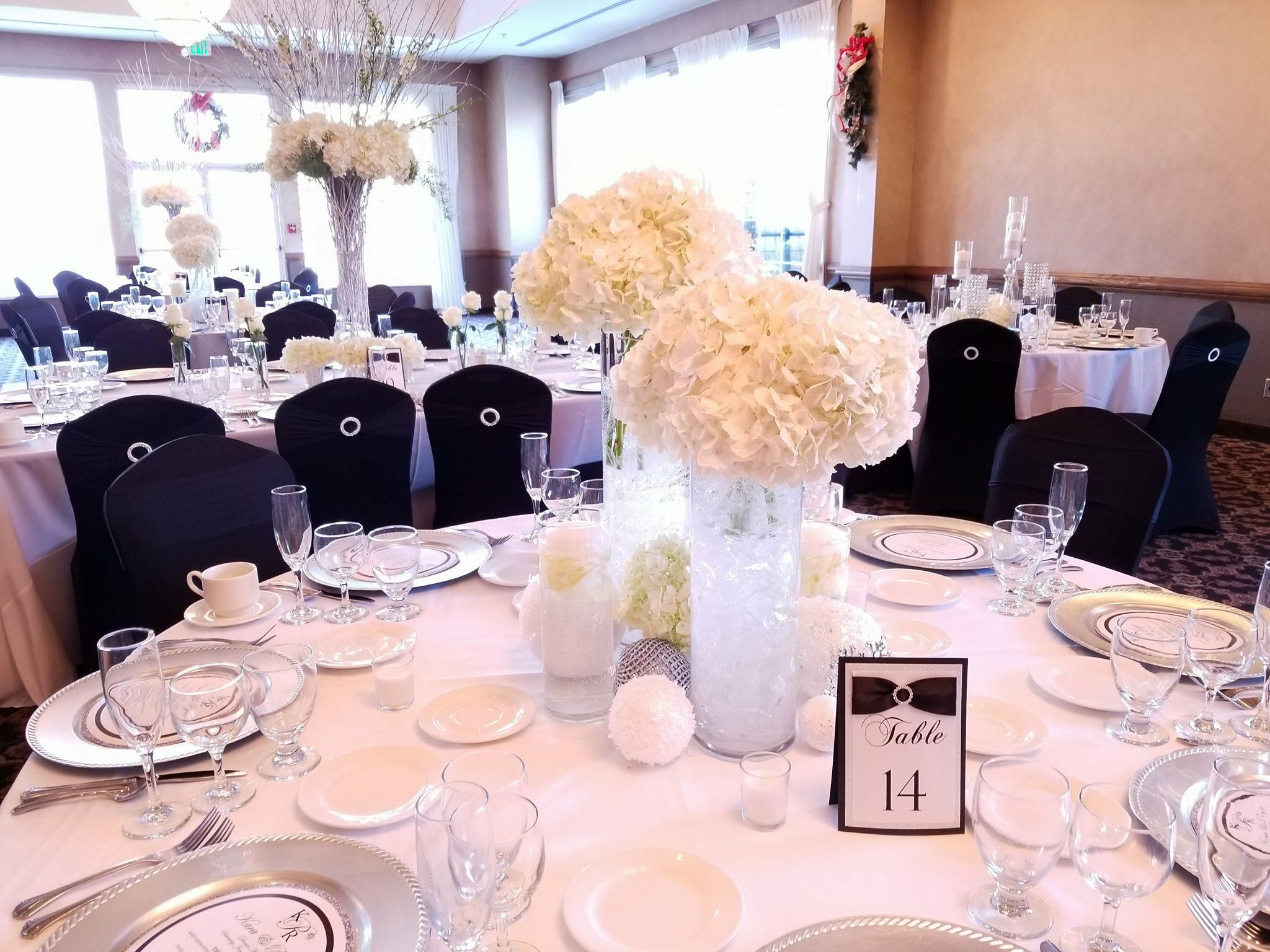 Black ribbons on the table number tents with a little