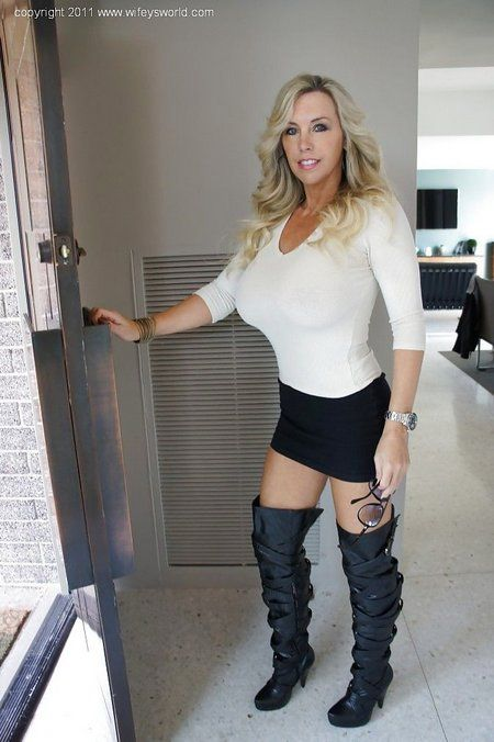 Hot milf babe in stripe boots