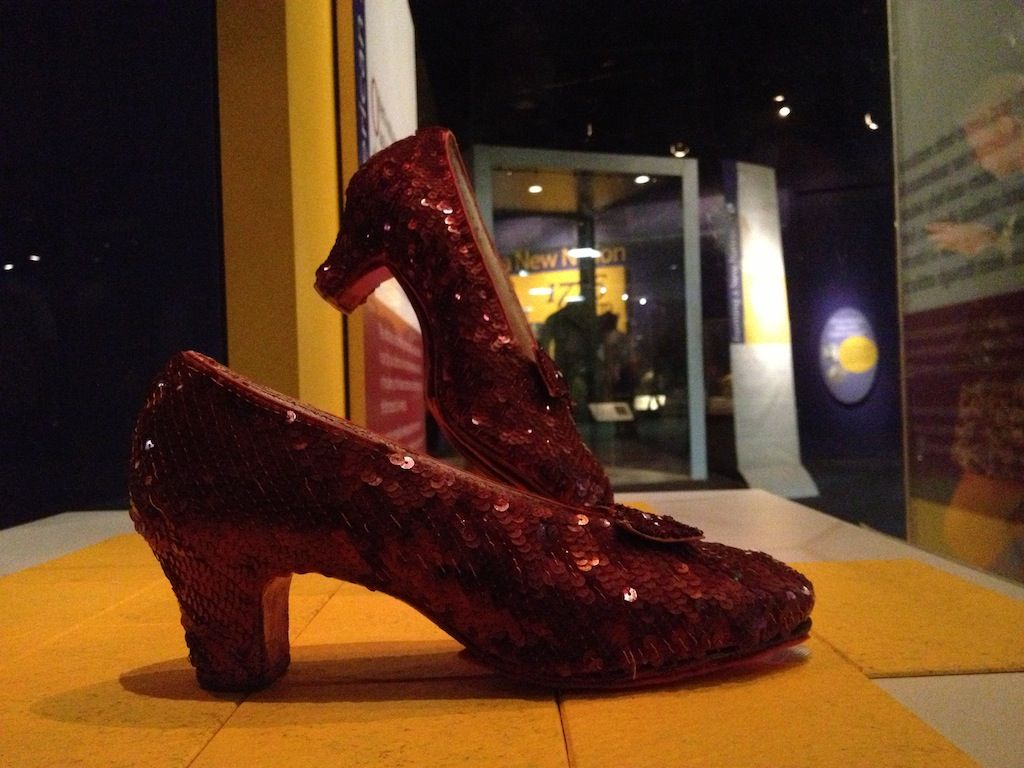 Dorothys ruby slippers follow the yellow brick road