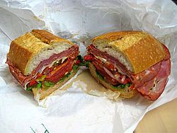 """Submarine Sandwich or sub, wedge, hoagie, hero, grinder. The sandwich originated in several different Italian American communities in the Northeastern United States in the late 19th. Portland, Maine claims to be the birthplace of the """"Italian sandwich"""" and it is considered Maine's signature sandwich."""