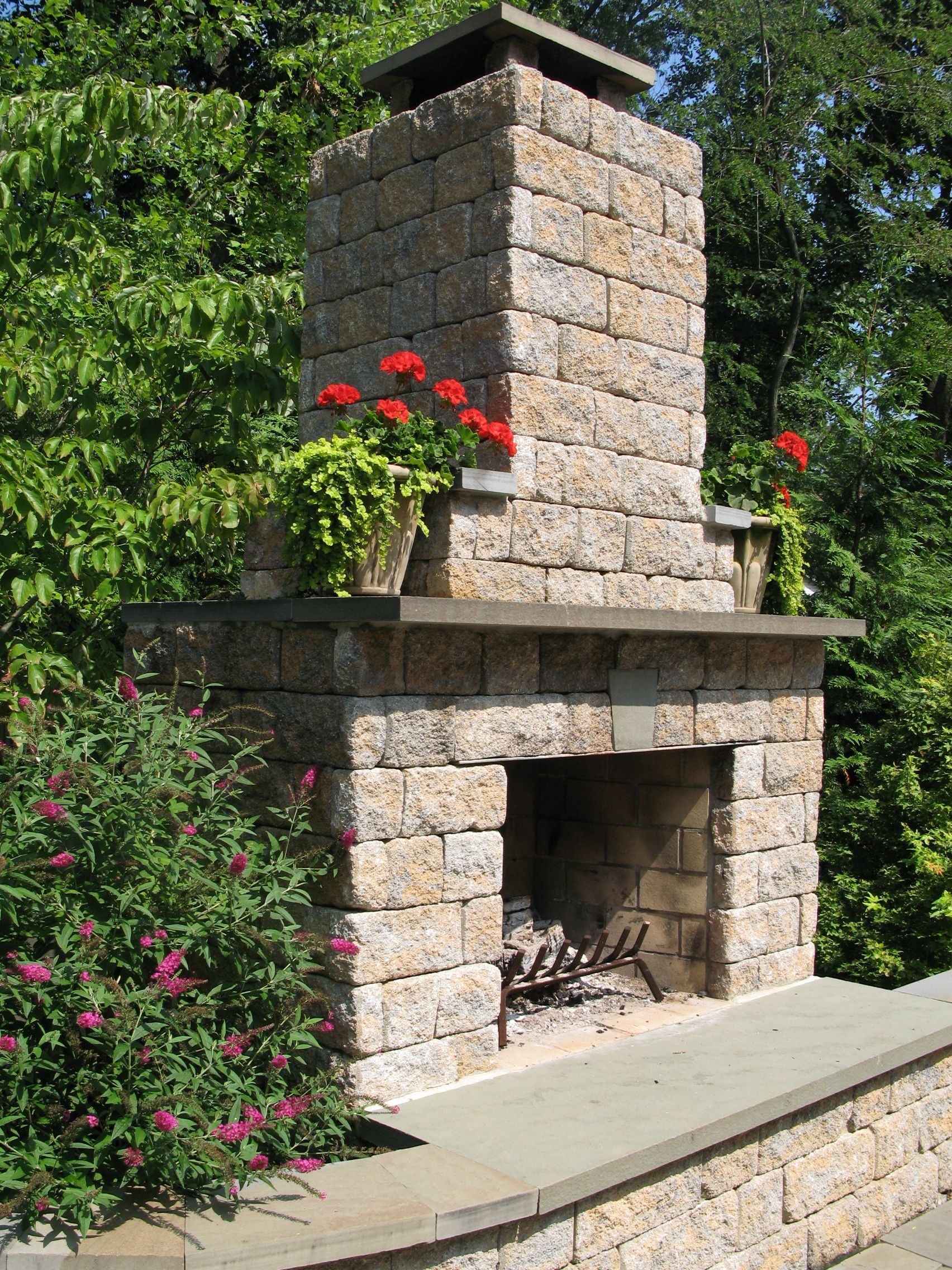 Outdoor Fireplace using Allan Block | Backyard fireplace ... on Building Outdoor Fireplace With Cinder Block id=93108