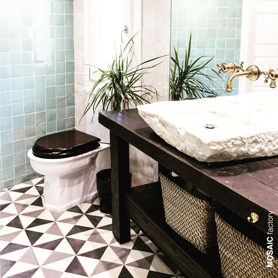 White And Grey Bathroom Floor Cement Tile With A Geometric Windmill Pattern Combined With Geometric Tiles Bathroom Bathroom Wall Decor Diy Bathroom Floor Tiles