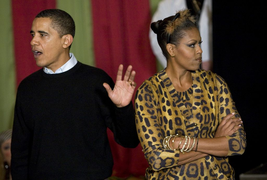 Michelle Obama Barack Obama Photos Photos - (AFP OUT) President Barack Obama and…