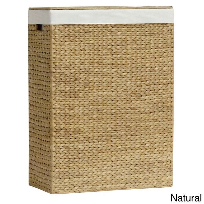 Decorate your bathroom with this unique hamper featuring a cotton, wood and hand-twisted water hyacinth leaf construction. This divided family hamper is complete with individual removable cotton liners and cutout side handles.