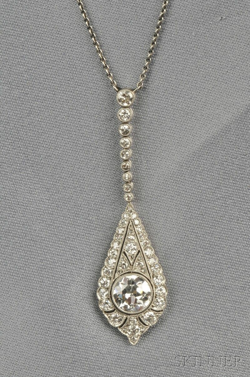 Art deco platinum and diamond pendant bezelset with an old