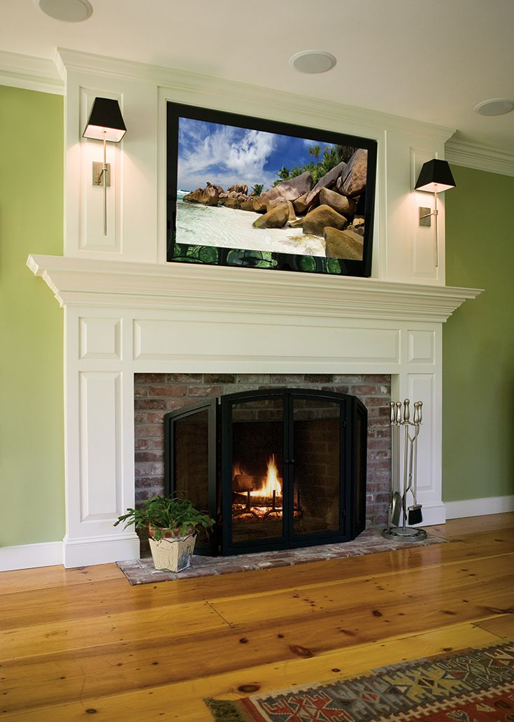 A Custom Built In Fireplace Mantel With Tv Mounted Above