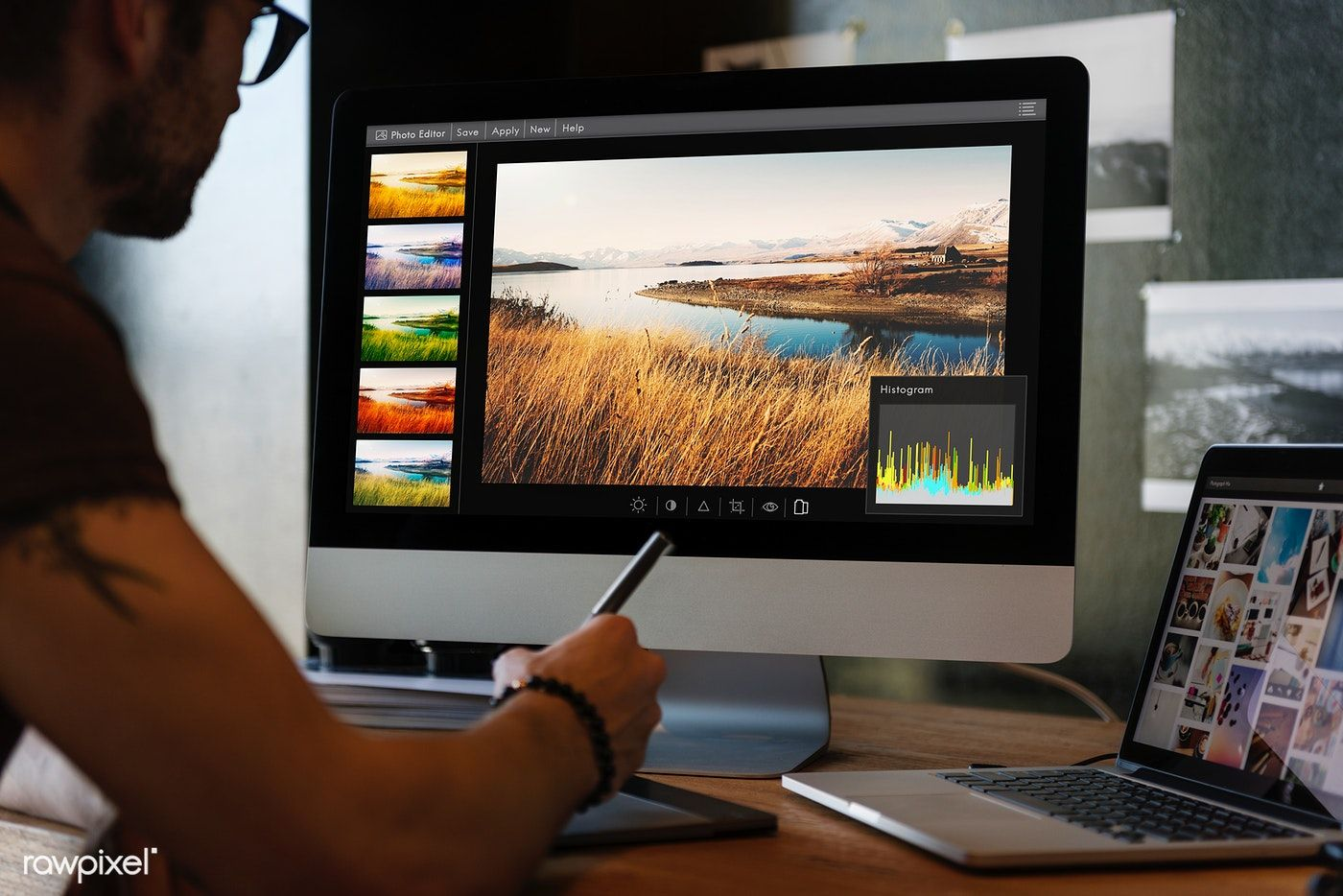 Download premium photo of man editing photos on a computer