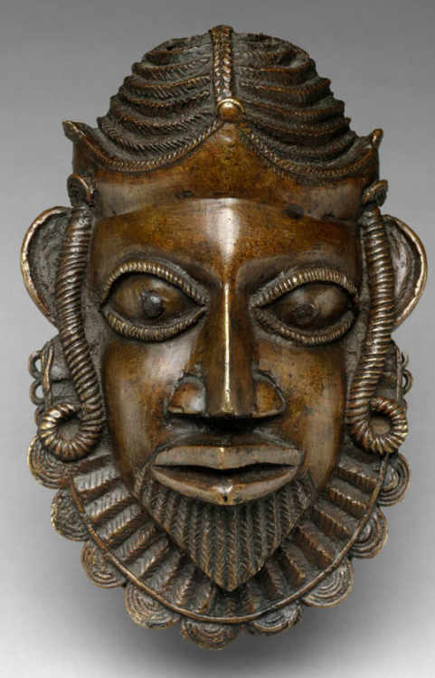 medievalpoc: Unknown Jeweler/Metalworker Nigerian Brooch of a Portuguese Face, Hip Ornament Edo, Court of Benin (c. 1500) Worked Brass Merchants and explorers from Portugal first made contact with the kingdom of Benin in 1486, initiating an economic relationship that ultimately had a profound impact upon the art and politics of this West African state. Benin's oral histories relate how Oba Esigie, who ruled Benin in the early sixteenth century, skillfully utilized these new trading partners…