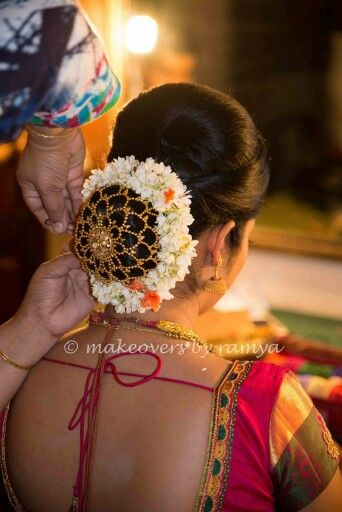 What A Beautiful Low Bun With Real Flower Gajra Juda Net Care However Should Be Take Beautiful Wedding Hair Bridal Hairstyle Indian Wedding Bridal Hair Buns