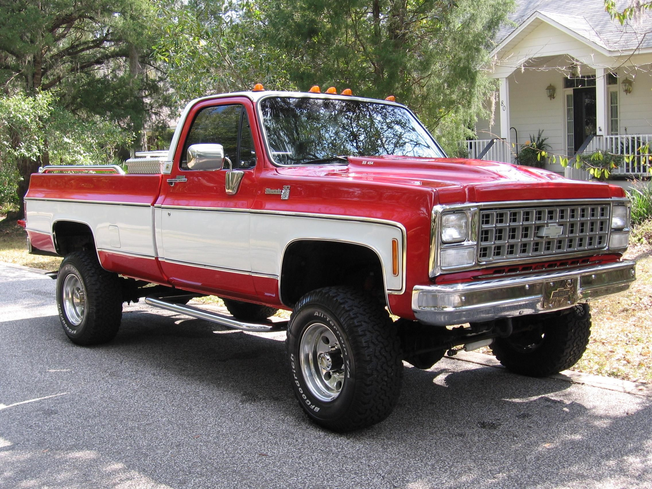 Red and white two tone lifted Chevrolet truck | Silly Boys, Trucks ...