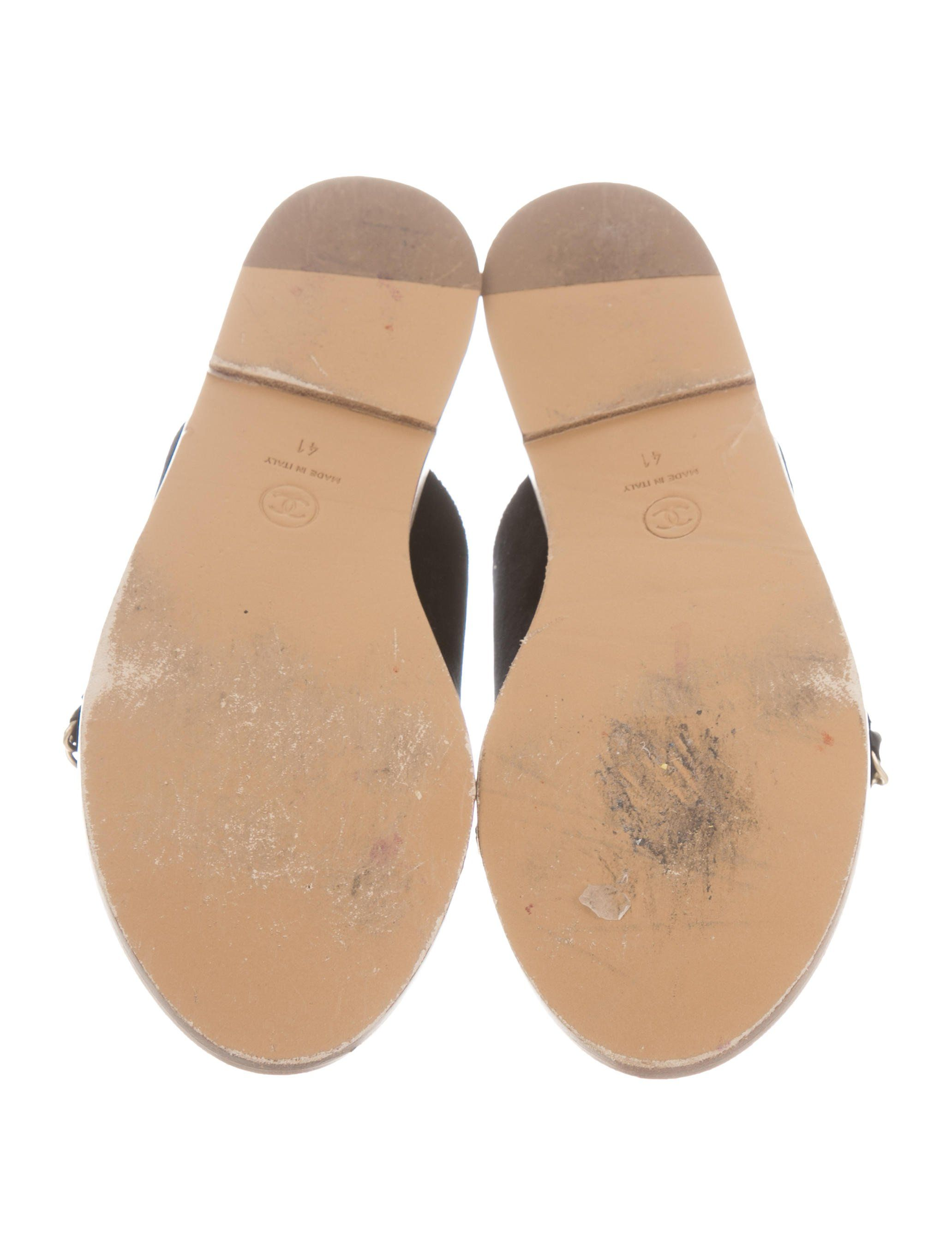 d331d3c8ab62 Black velvet Chanel slide sandals with gold-tone interlocking