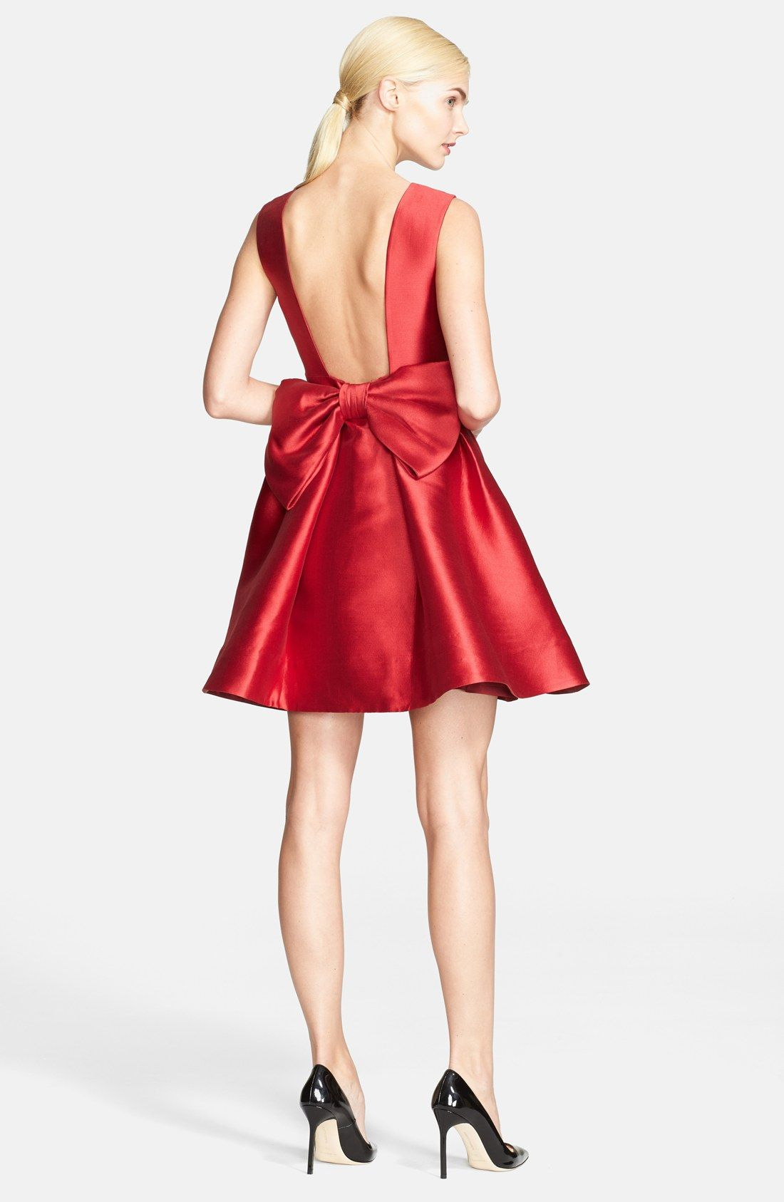 df9d869be38 Ooh la la! The low back finished with a bow is breathtaking. This red Kate  Spade fit   flare minidress is perfect for party season.