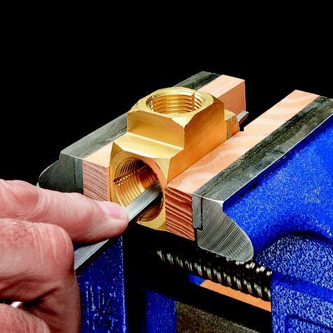 File slots in the threads to cut the threads on the wooden parts.