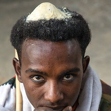 afar man with butter in hair