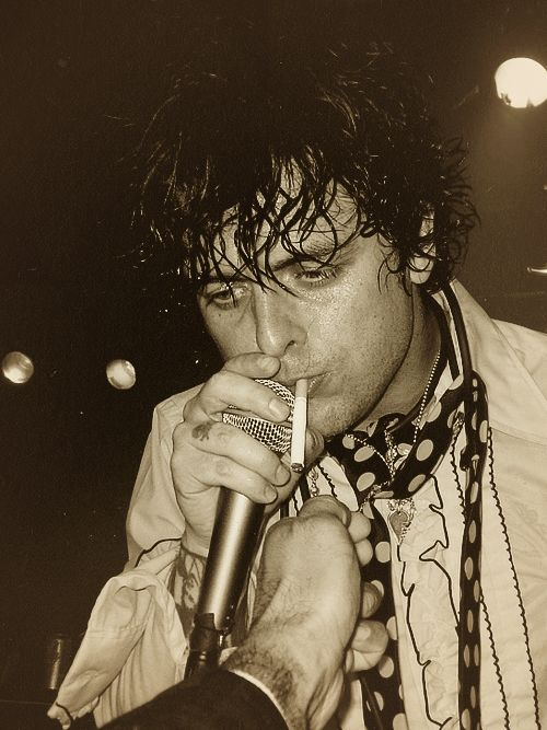 Billie Joe Armstrong smoking a cigarette (or weed)