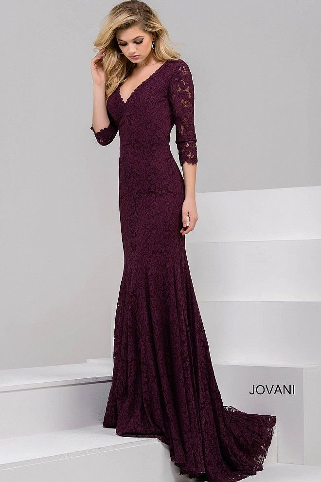 c145a692f92f Simple and sophisticated floor length form fitting burgundy lace evening  gown features three quarter sheer sleeve bodice with v neckline and train.