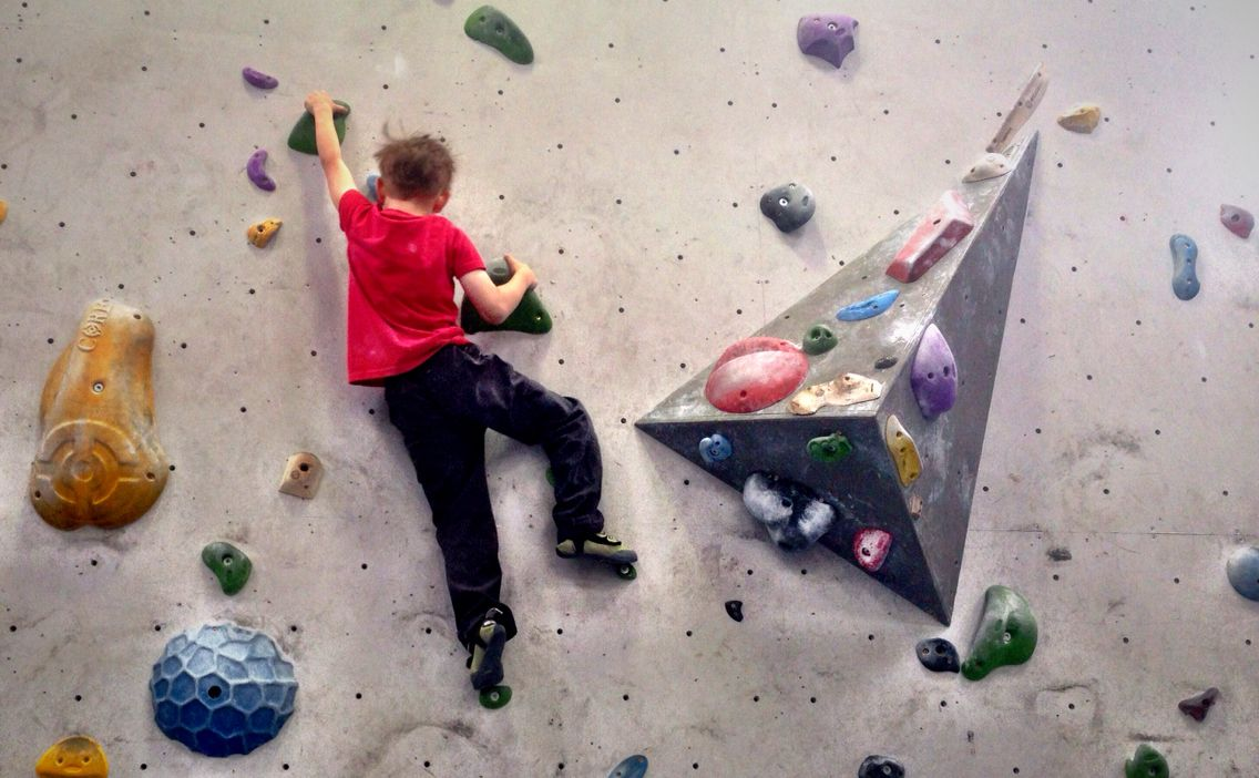 Ruben (age 6) stretching between holds at Bloc (they're all a stretch when ur 6!)