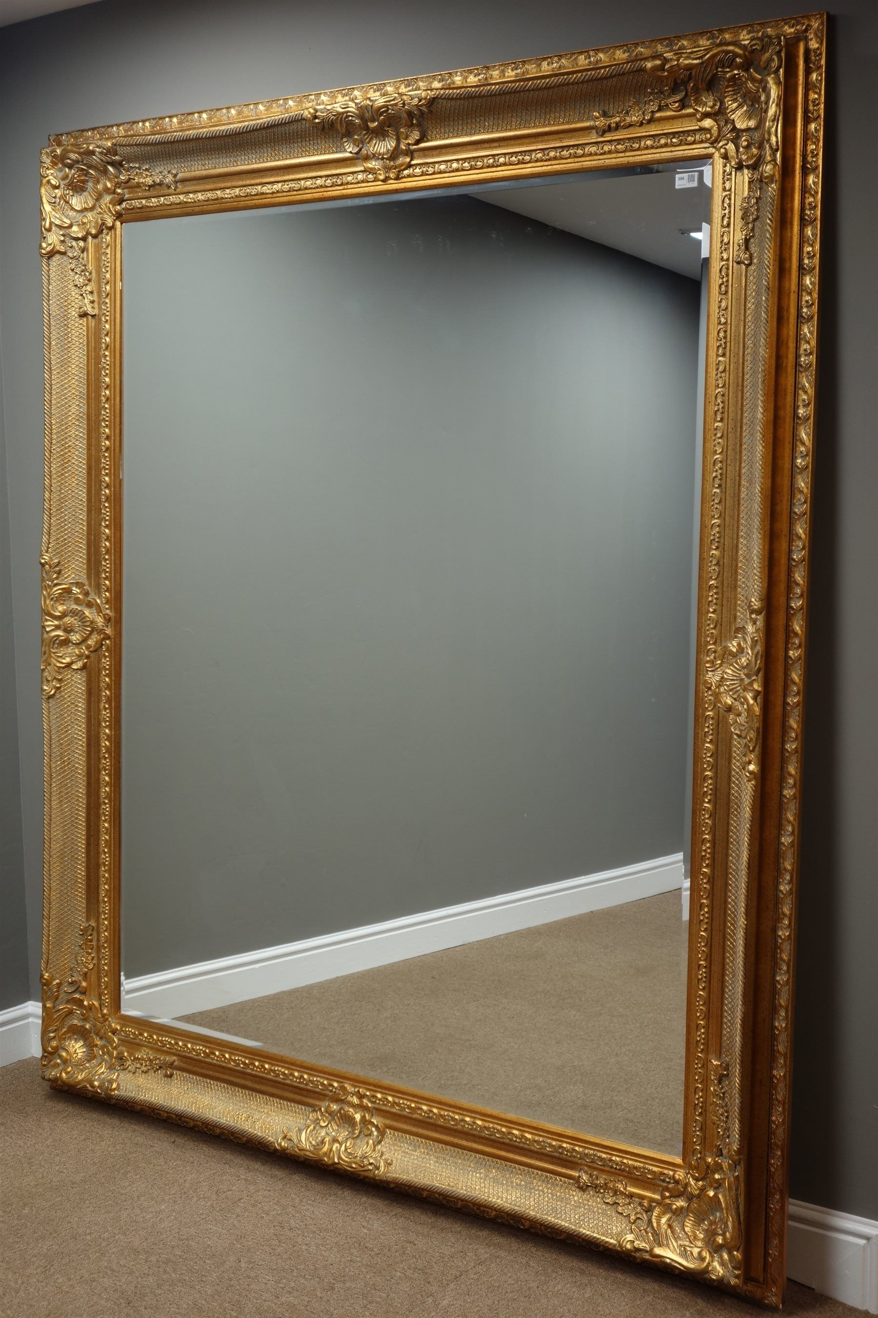 1a9b42653ce7a9 Large rectangular bevelled edge wall mirror in ornate swept gilt frame,  170cm x 200cm Duggleby auctioneers, open to offers. Could silver leaf?