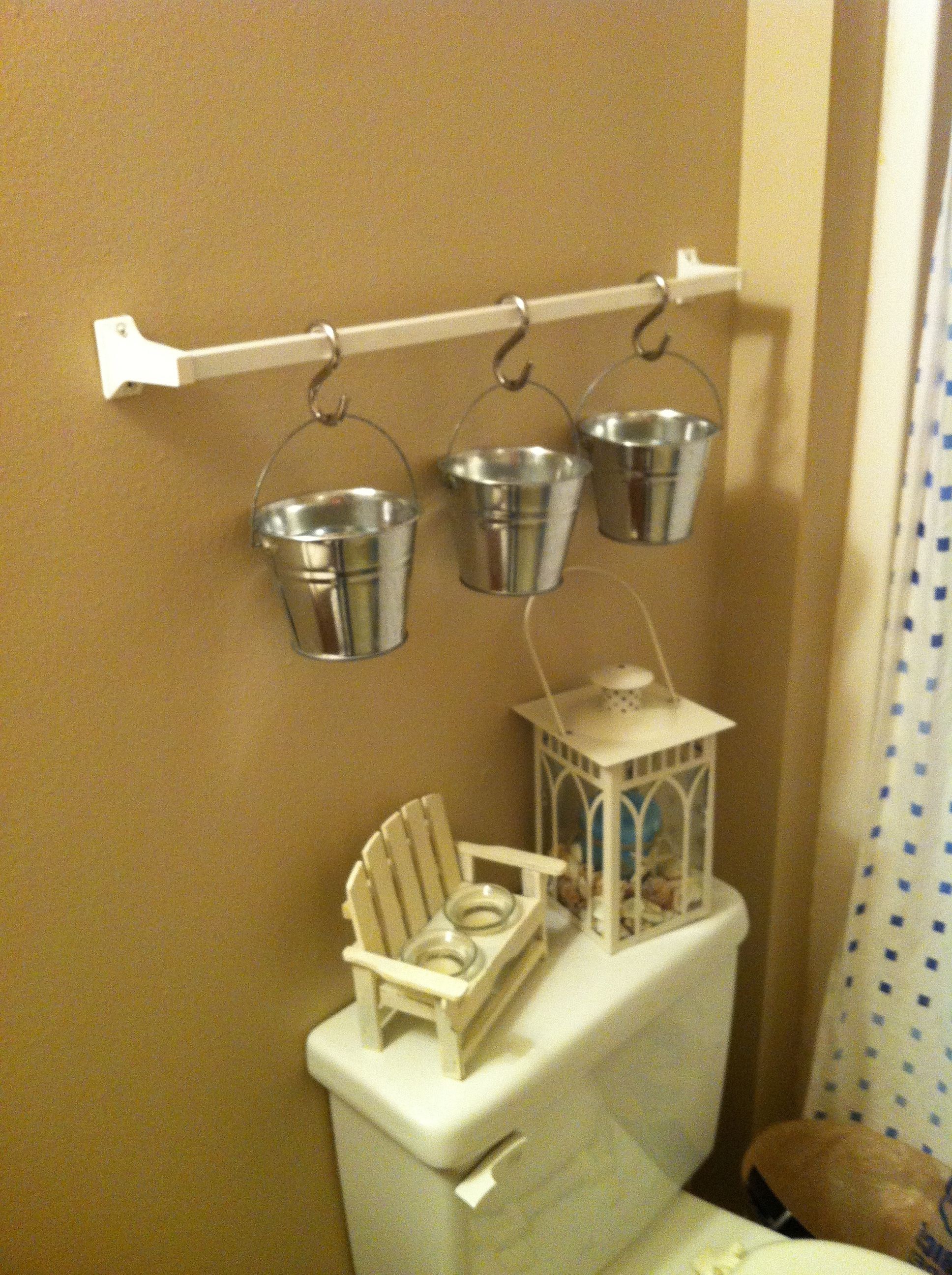 Homemade IKEA hanging totes! Picked up hooks from home depot! I got buckets from hobby lobby!