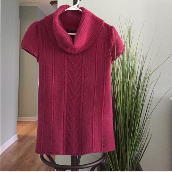 BCBG sweater Raspberry colored short sleeved sweater. Previously loved. Taken well care, but it did shrink a bit but still hits at hips. Mild sweater pilling. BCBGMaxAzria Sweaters Cowl & Turtlenecks