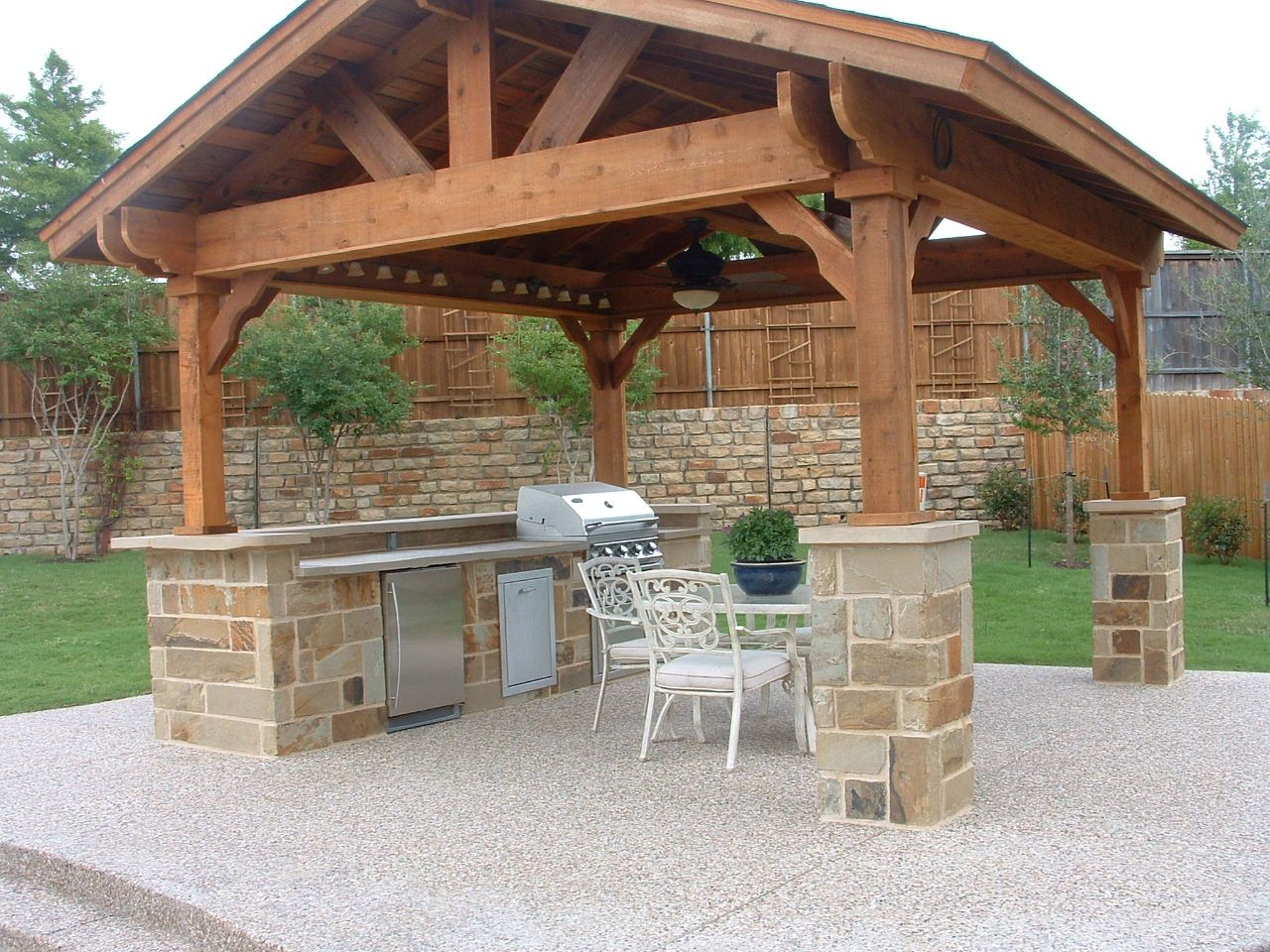 Covered outdoor living spaces standalone shingled roof for Outdoor kitchen roof structures
