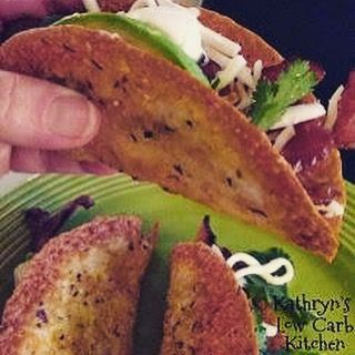 . Provolone Taco Shells . Ingredients: Round Provolone Cheese slices (I bought mine at Costco) Garlic powder Mexican Spices . Oven 375 degrees . Place Parchment paper on a cookie sheet....Spray lightly with nonstick cooking spray. Evenly space 3 slices of Provolone Cheese on the parchment.. Sprinkle lightly with garlic powder and Mexican spices.... I used a sa...