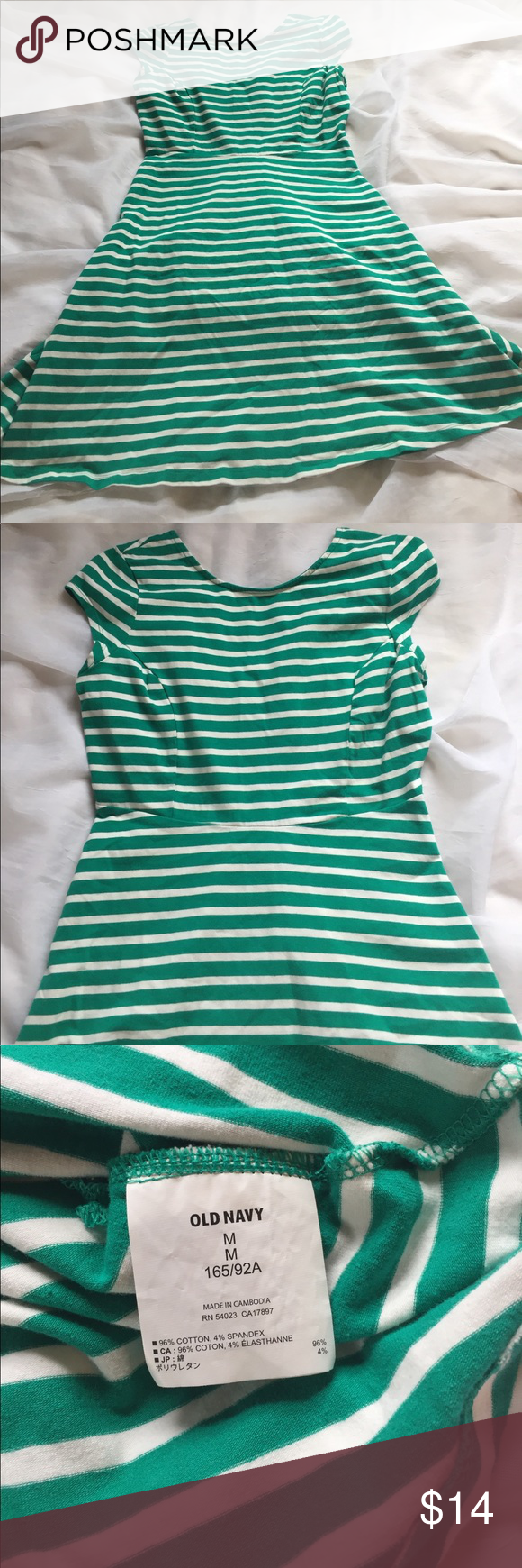 "Old Navy striped stretch dress, Ned Green and white striped dress by ON, with a stretch material and scoop back. Size medium, with 35"" bust, 29"" waist, and 35"" length. 🦊 I do not model or trade. Please use measurements provided and ask any questions prior to purchase. My goal is a five star happy customer! 😊 Old Navy Dresses Mini"