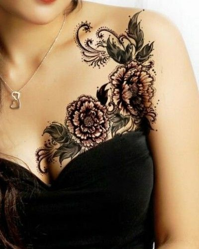 This feminine tattoo of flowers and leaves could be lowered to hide a mastectomy tattoo.  P.ink.org