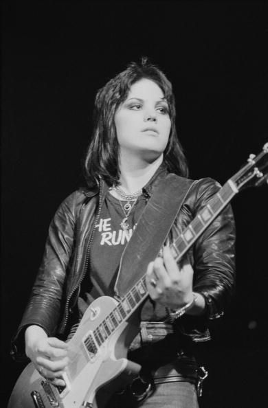 Singer and guitarist Joan Jett of American band The Runaways performs on stage at the Free Trade Hall in Manchester England on November 12 1977