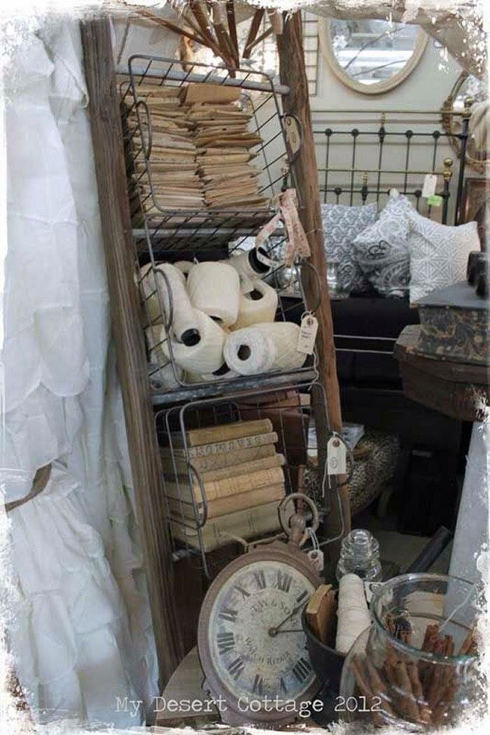 Love this idea for a booth with a ladder and baskets