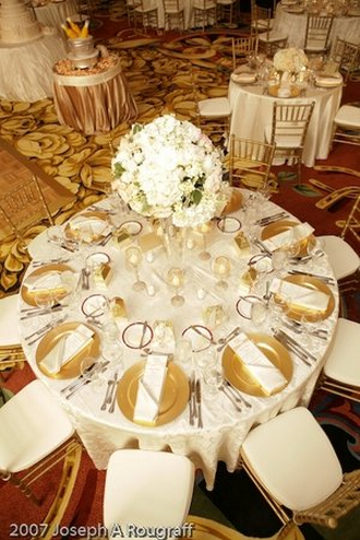 Use gold charger plates on your tables to transform a simple place ...