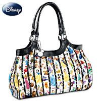 Printed fabric tote with brown faux leather trim features dozens of Disney  characters and a Tinker Bell charm. Multiple pockets and zip closure. 88d68caae9a40