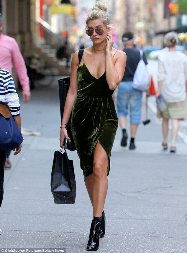 b34d8429f261 She wore green velvet: Hailey Baldwin showed some skin in a low-cut green  velvet dress with daring thigh-high slit while out in New York City on  Monday