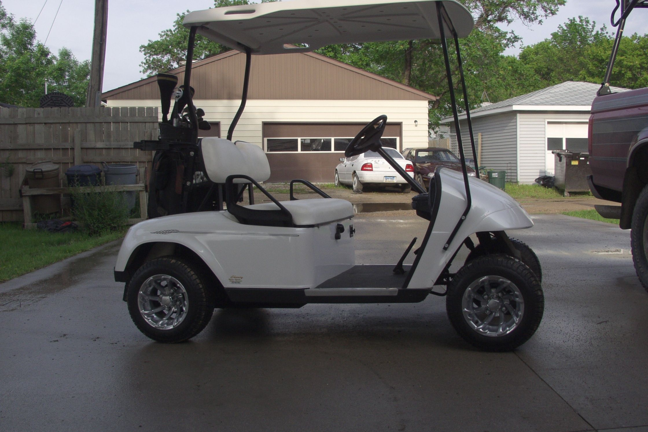 2002 Ez Go gas golf cart, Pearl white paint , carbon Fiber dash , custom rims and tires.