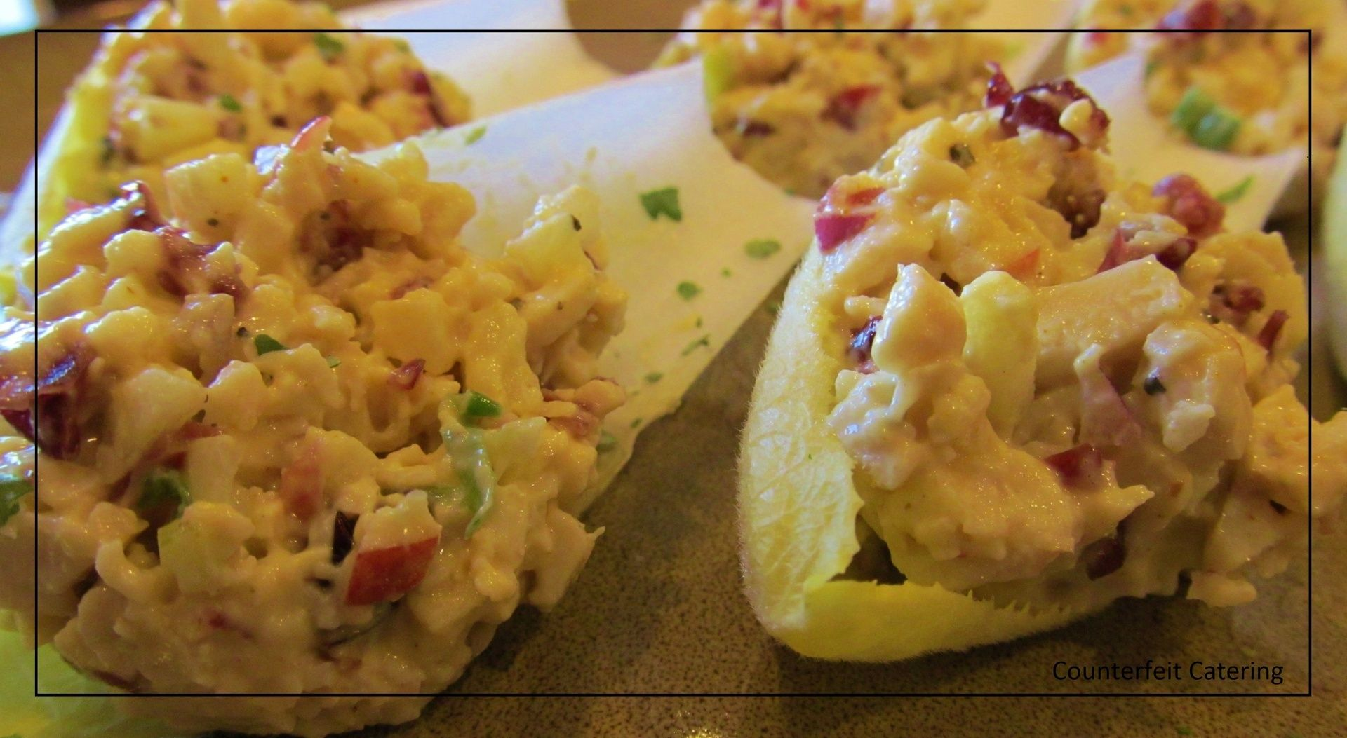 Curried chicken salad on endive counterfeit catering