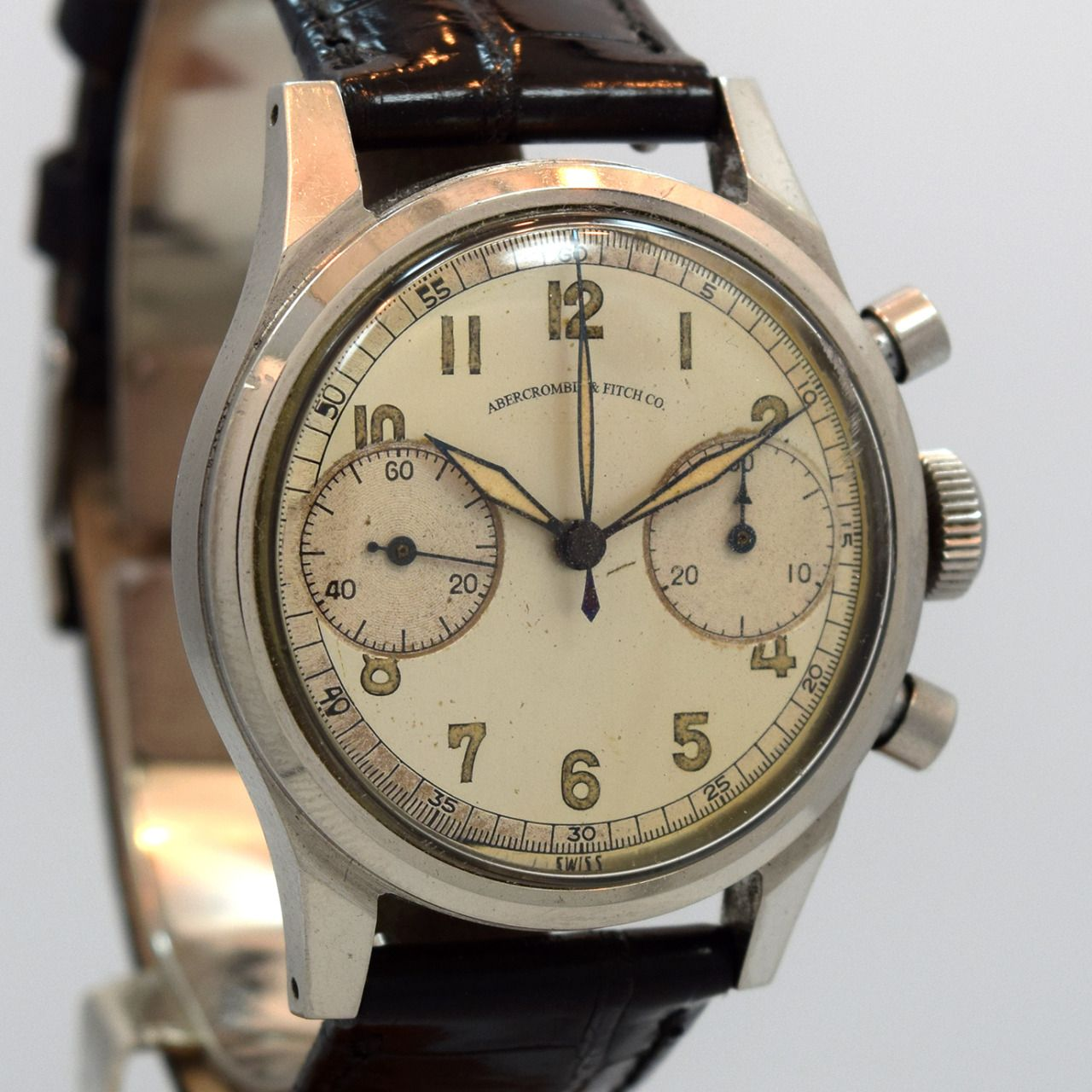 A 1950s vintage Abercrombie and Fitch Co. 2 Register Chronograph stainless steel watch with a patinated silver dial. (Store Inventory # 7612, listed at $3250). #ambercrombie #fitch #chronograph #cool #watch #watches #timepieces #vintage #stawc