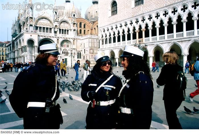 http://www.visualphotos.com/photo/1x3746823/three_female_police_officers_in_venice_italy_three_female_police_officers_in_venice_italy_in_pi_...