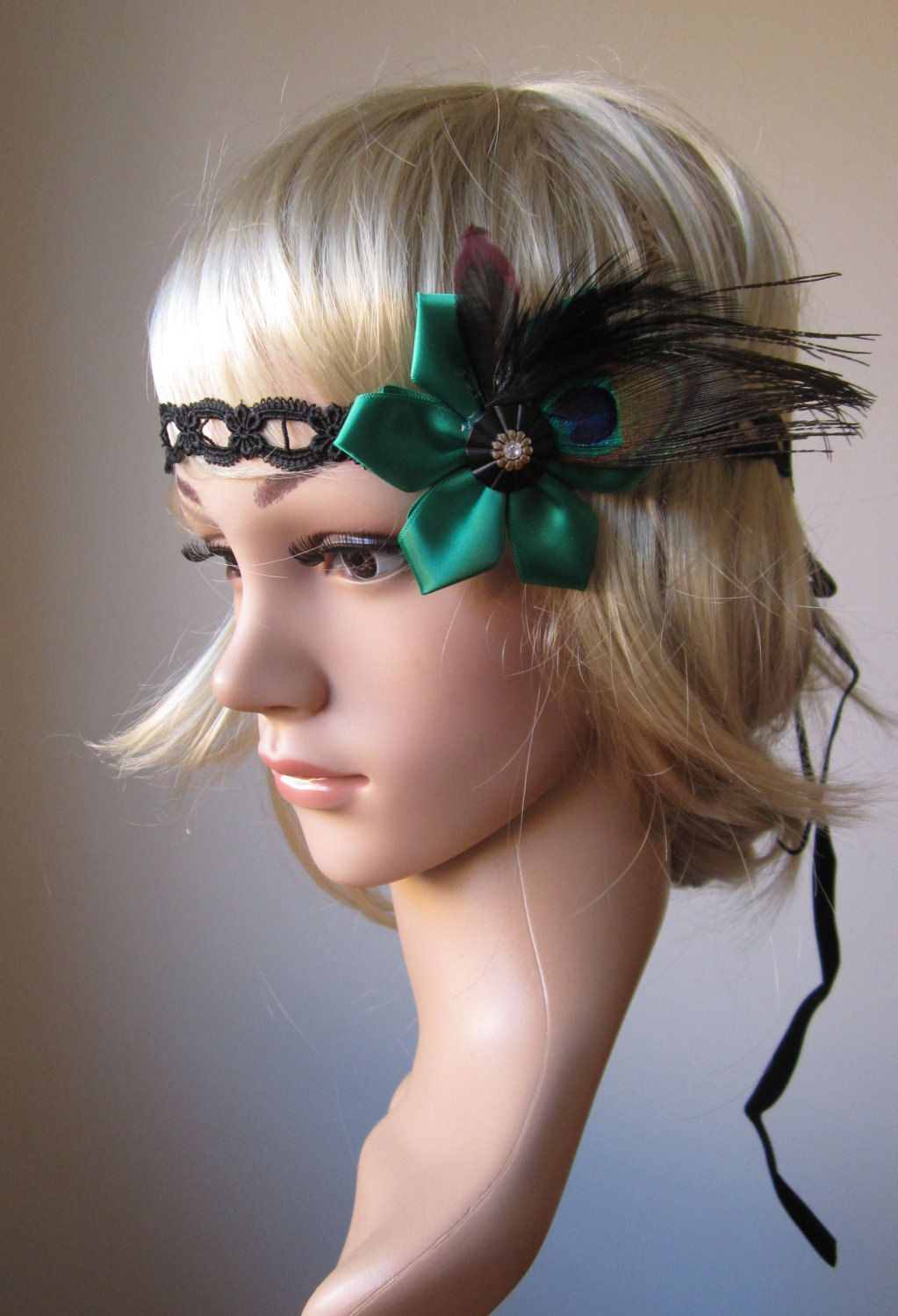 Peacock feather 1920s flapper style headband with green satin flower. $30.00, via Etsy.