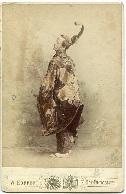 """Tinted cabinet photograph of Allen Morris as The Mikado in a DOC touring production of """"The Mikado"""" in 1887. Photo by W. Höffert, Dresden, Leipzig, Hannover, Hamburg and Berlin. Pencil note on reverse identifies D'Oyly Carte's 'D' Company 1887."""