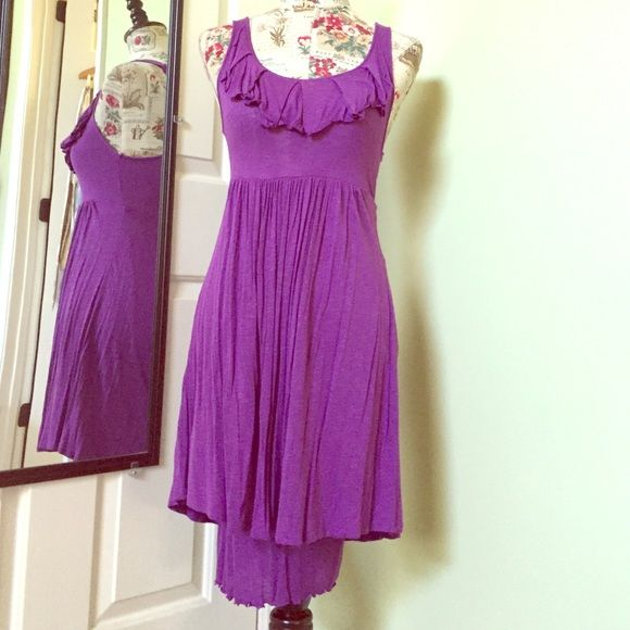 Purple Sundress This dress is very comfortable and cute. It has a stretchy slightly fitted underskirt and a full top skirt. The fabric is very soft and feels like a very soft tee. Their is a discoloration spot on the bodice but it is not very noticeable. I think it came that way. This dress hasn't been worn much. Great summer dress! EUC Dresses Midi