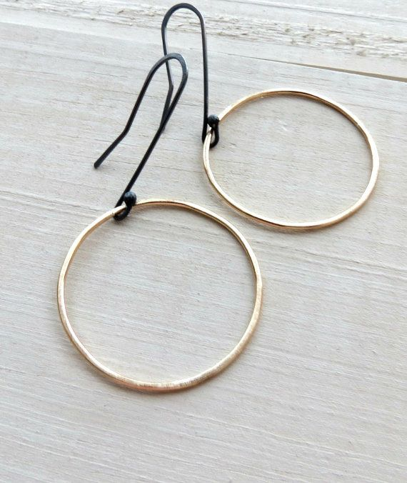 0ac695945 Modern gold dangle hoops. Simple gold earrings made from hammered 14k gold  filled wire and sterling silver. The Sterling silver ear wires have