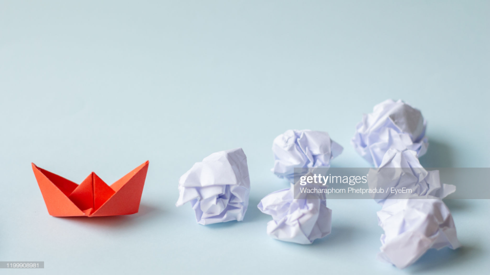 Close Up Of Paper Boat And Crumpled Paper Ball Over White Background Paper Boat Paper Balls Crumpled Paper